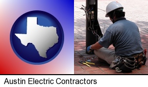 Austin, Texas - an electrician wearing a tool belt, installing electrical wiring