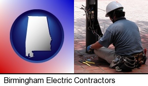 Birmingham, Alabama - an electrician wearing a tool belt, installing electrical wiring