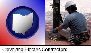an electrician wearing a tool belt, installing electrical wiring in Cleveland, OH