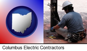 an electrician wearing a tool belt, installing electrical wiring in Columbus, OH