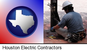 an electrician wearing a tool belt, installing electrical wiring in Houston, TX