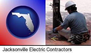 Jacksonville, Florida - an electrician wearing a tool belt, installing electrical wiring