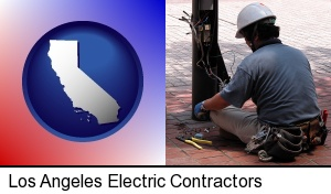 an electrician wearing a tool belt, installing electrical wiring in Los Angeles, CA
