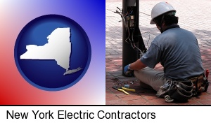 New York, New York - an electrician wearing a tool belt, installing electrical wiring