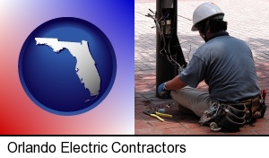 Orlando, Florida - an electrician wearing a tool belt, installing electrical wiring