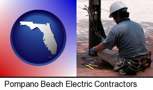 Pompano Beach, Florida - an electrician wearing a tool belt, installing electrical wiring