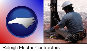 an electrician wearing a tool belt, installing electrical wiring in Raleigh, NC