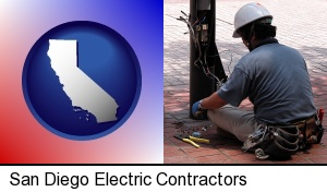an electrician wearing a tool belt, installing electrical wiring in San Diego, CA