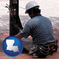 louisiana an electrician wearing a tool belt, installing electrical wiring