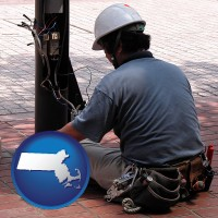 an electrician wearing a tool belt, installing electrical wiring - with MA icon