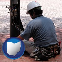 an electrician wearing a tool belt, installing electrical wiring - with OH icon