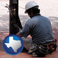texas an electrician wearing a tool belt, installing electrical wiring
