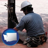 washington an electrician wearing a tool belt, installing electrical wiring