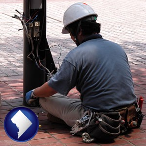 an electrician wearing a tool belt, installing electrical wiring - with Washington, DC icon