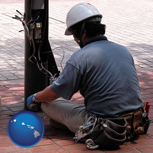 an electrician wearing a tool belt, installing electrical wiring - with Hawaii icon