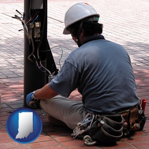 an electrician wearing a tool belt, installing electrical wiring - with Indiana icon
