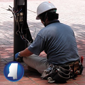 an electrician wearing a tool belt, installing electrical wiring - with Mississippi icon