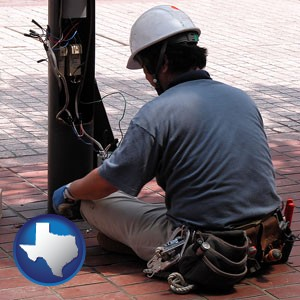 an electrician wearing a tool belt, installing electrical wiring - with Texas icon
