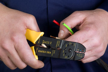 an electrician using a wire stripper